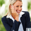 Successful business woman smiling during a conference - Stock Photo