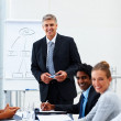 Business man during a boardroom meeting with colleagues - Stock Photo