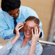 Royalty-Free Stock Photo: Business man surprising colleague by covering her eyes
