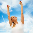 Royalty-Free Stock Photo: Woman with open arms against the sky