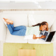 Top view of an African American female lying on sofa - Stock Photo