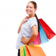 Royalty-Free Stock Photo: Cute woman with shopping bags on white