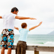 Royalty-Free Stock Photo: Freedom - Father and son enjoying at the beach