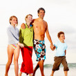 Royalty-Free Stock Photo: Happy family on a vacation, walking on the sea shore