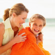 Royalty-Free Stock Photo: Happy mother and daughter while on a beach vacation