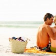 Royalty-Free Stock Photo: Rear view of a romantic couple sitting at the beach
