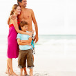 Royalty-Free Stock Photo: Happy family on their beach vacation, looking away