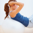 Sexy young female exercising on a fitness ball - Stockfoto