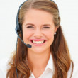 Closeup of an attractive woman wearing headset on white backgrou - Stock Photo