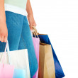 Royalty-Free Stock Photo: Mid section of a woman with shopping bags, white background