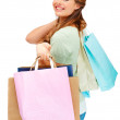 Royalty-Free Stock Photo: Cute young female smiling with shopping bags on white