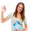 Royalty-Free Stock Photo: A happy student gesturing over white background