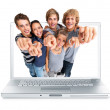Royalty-Free Stock Photo: Young college students pointing through a laptop screen