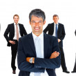 Royalty-Free Stock Photo: Confident business man with team of staff in a line at the back,