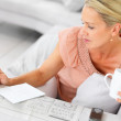 Royalty-Free Stock Photo: Woman finding jobs in the newspaper classifieds