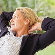 Middle age business woman relaxing, isolated - Stok fotoğraf