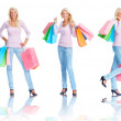Beautiful young female holding shopping bags over white , multi - Stok fotoğraf