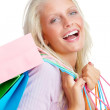 Royalty-Free Stock Photo: Happy young woman with colorful shopping bags on white