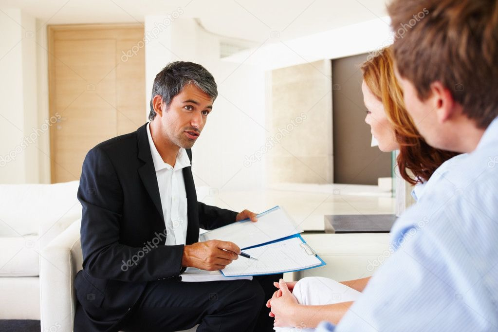 Financial advisor in discussion with a young couple — Stock Photo #3330331