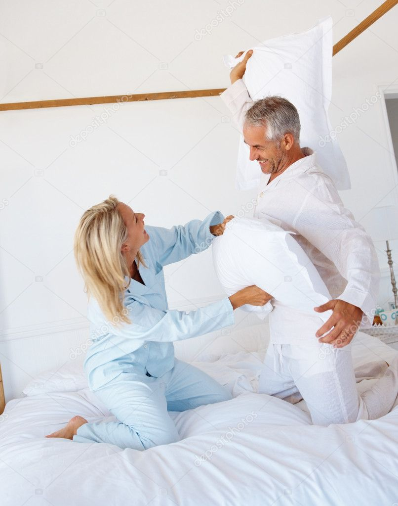 depositphotos 3330928 Pillow fight Happy mature couple enjoying themselves This young kitten is pregnant. Unless your female cat has been spayed, ...