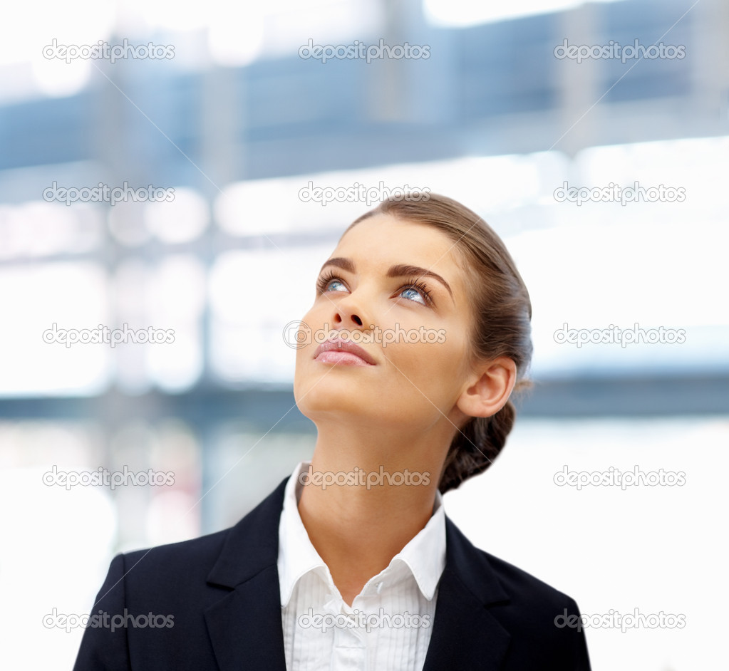 Portrait of a sweet young business woman looking upwards at copyspace — Photo #3331686