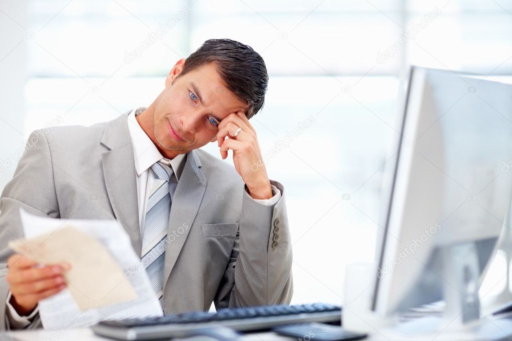 A young professional business man working hard in the office  Stock Photo #3332157