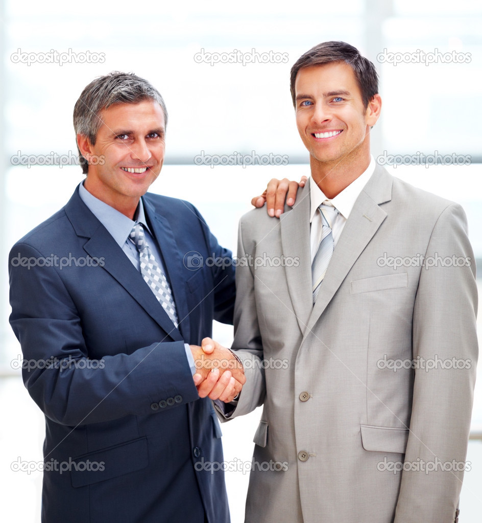 Portrait of successful business shaking hands with each other after a deal  Stock Photo #3332180