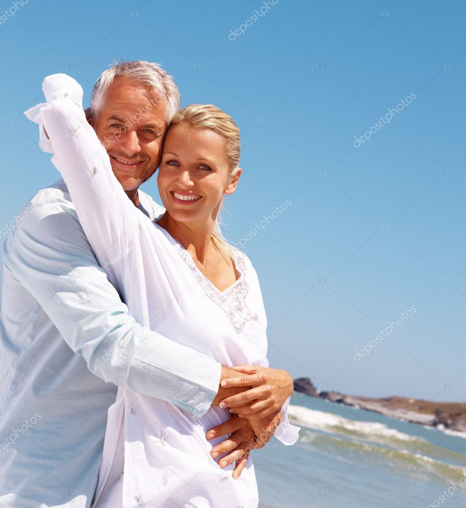 Portrait of a lovely aged couple on a vacation caring for each other — Stock Photo #3332535