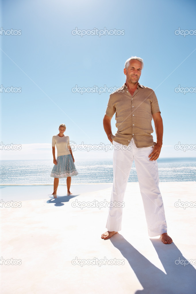 depositphotos 3332751 An aged old couple posing on the beach Old couple working together on computer stock photo, Senior man and woman ...