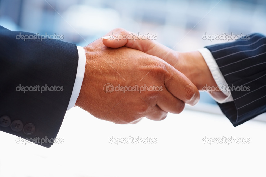 Closeup of a business hand shake between two colleagues  Stock Photo #3332956