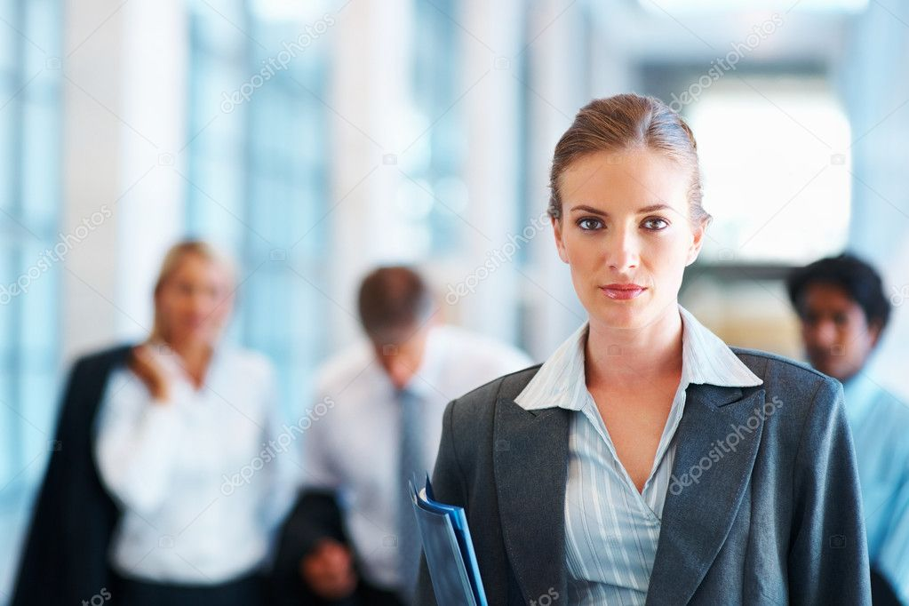 Portrait of a young business woman with colleagues at the background — Stok fotoğraf #3333090