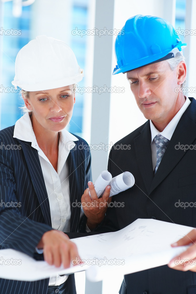 Portrait of two engineers busy discussing on a project — Stock Photo #3333356