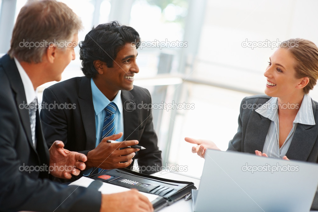 Team of colleagues in discussion at a business meeting — Stock Photo #3334113
