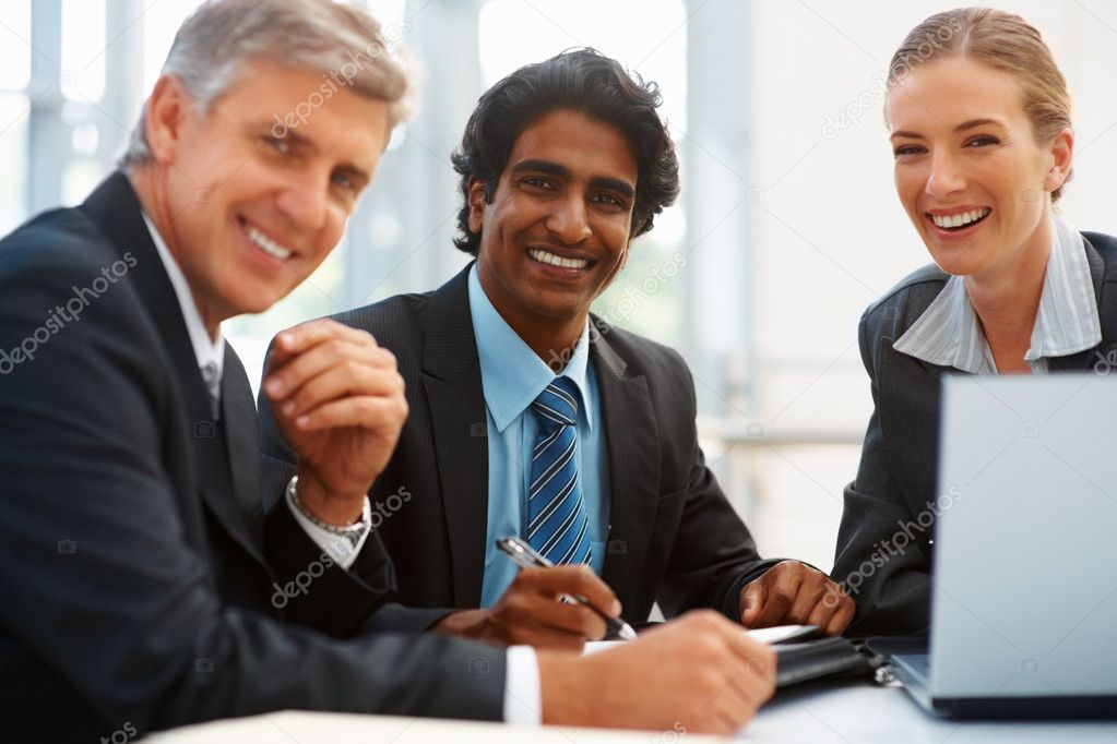 Happy team of business associates at a meeting  Stock Photo #3334143
