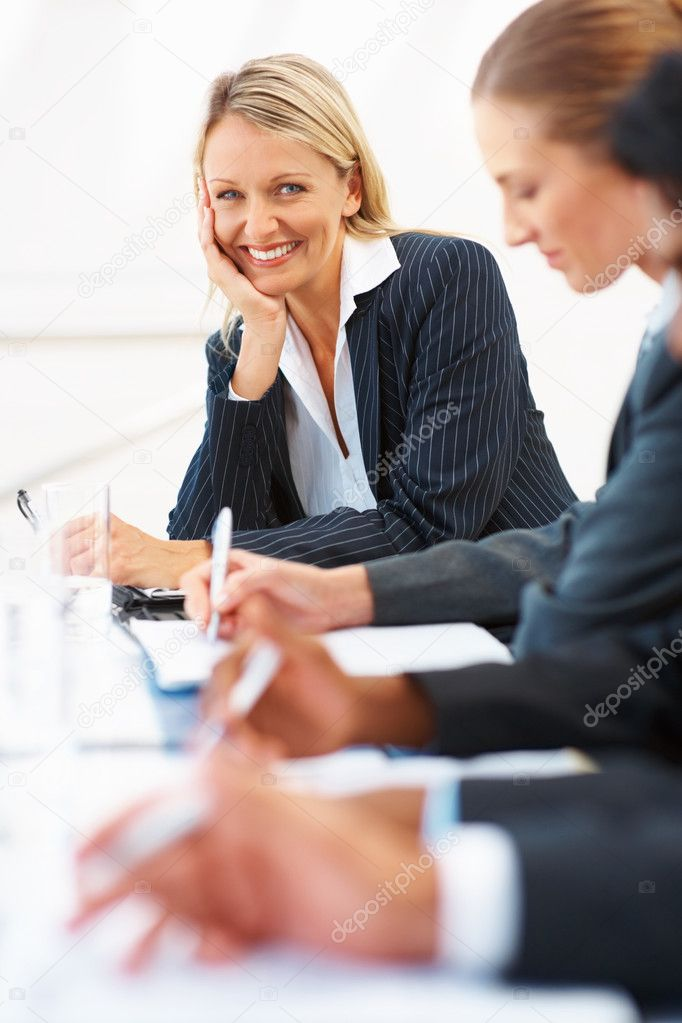 Cute business woman at a seminar with colleagues — Stock Photo #3334399