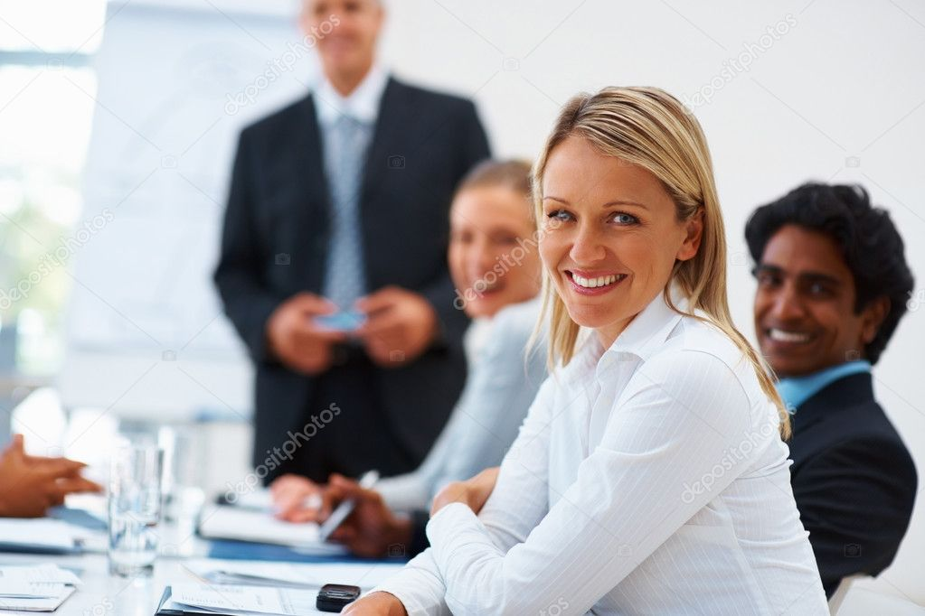 Young business woman with team smiling at the background — Stock Photo #3334447