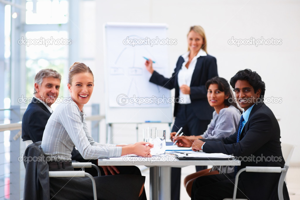 Portrait of confident happy business sitting in a conference for training — Zdjęcie stockowe #3334484