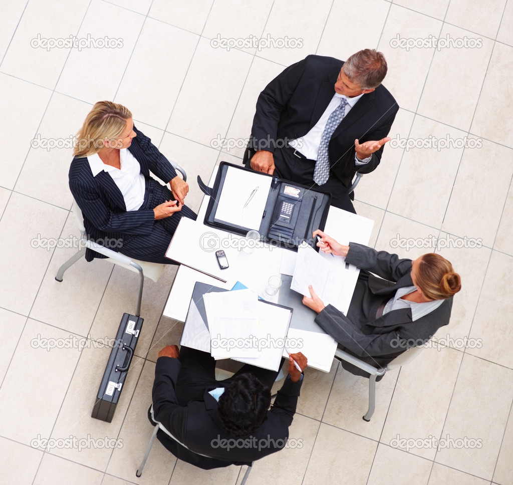Top view of a group of business having a meeting — Stock Photo #3334487