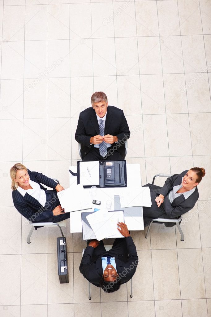 Above view of happy business sitting in the office and looking upwards — Stock Photo #3334493