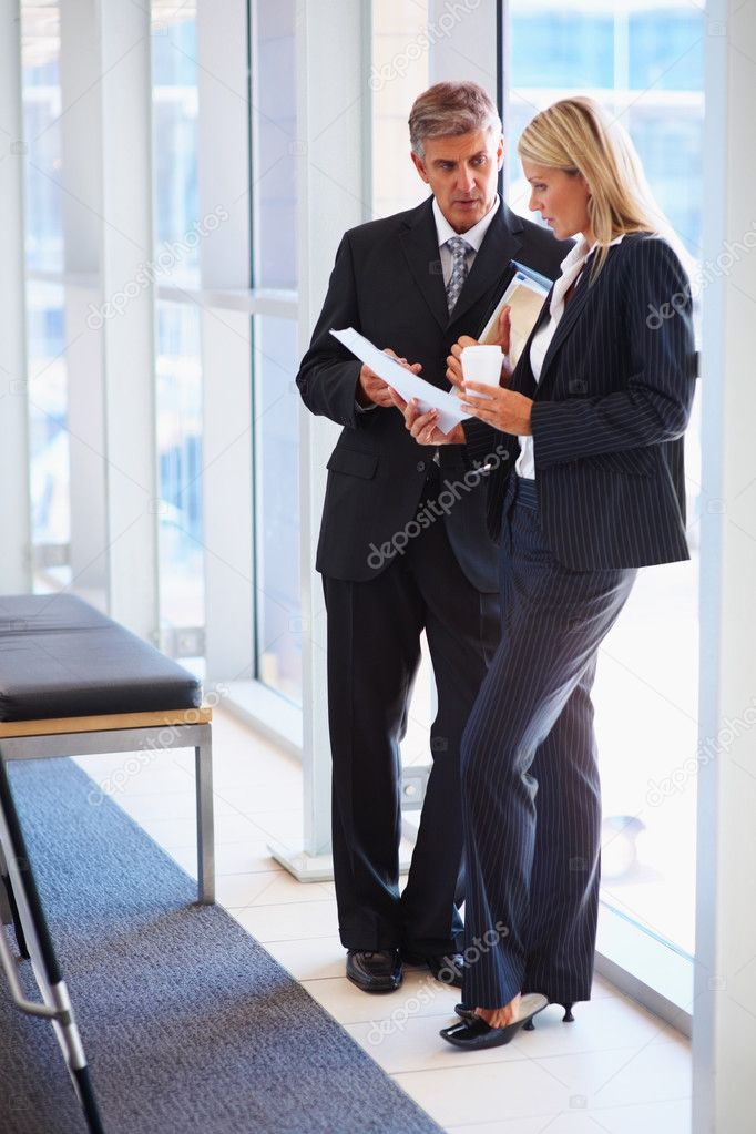 Full length portrait of two professional business discussing reports — Stock Photo #3334641