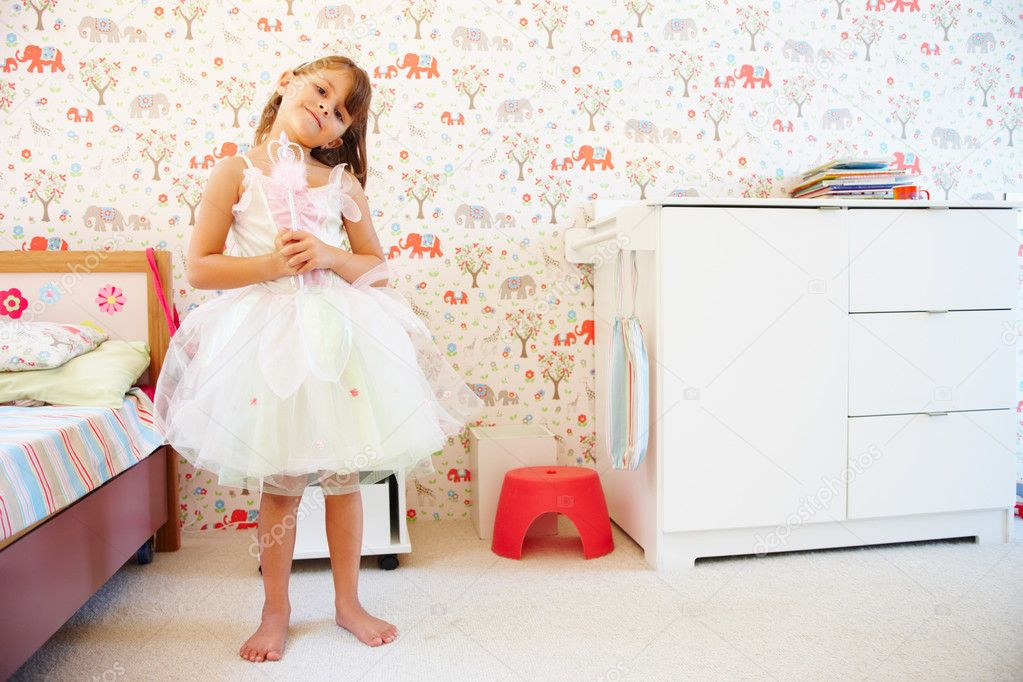 Full length portrait of a little girl wearing fairy's costume — Stock Photo #3335239