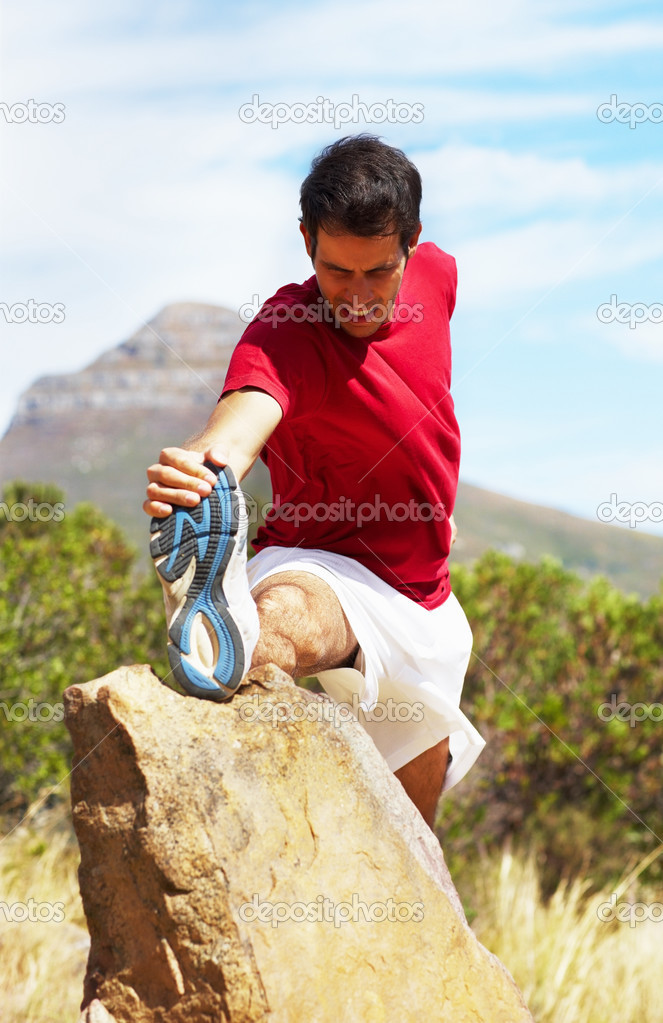Young athlete stretching leg in pain, outdoors — Stock Photo #3335297