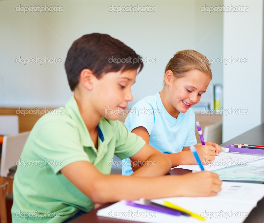 Loving children sitting together to their homework — Stock Photo #3335531