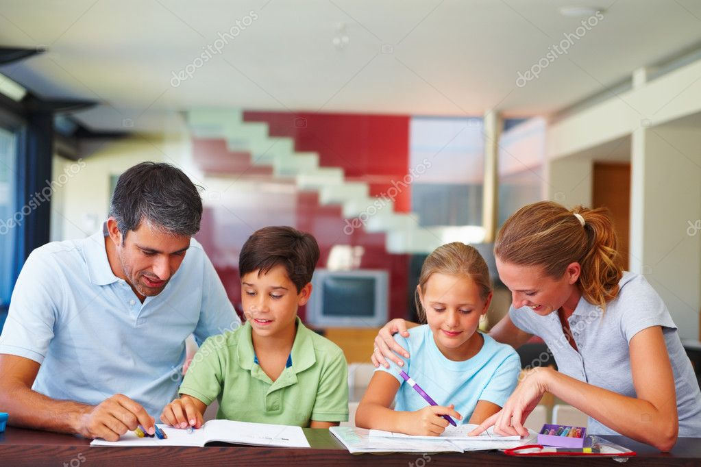 Parents helping their children with their homework  Stock Photo #3335551