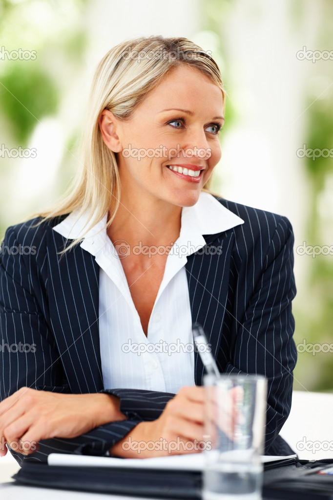 A lovely gorgeous business woman smiling at the meeting — Stock Photo #3336030