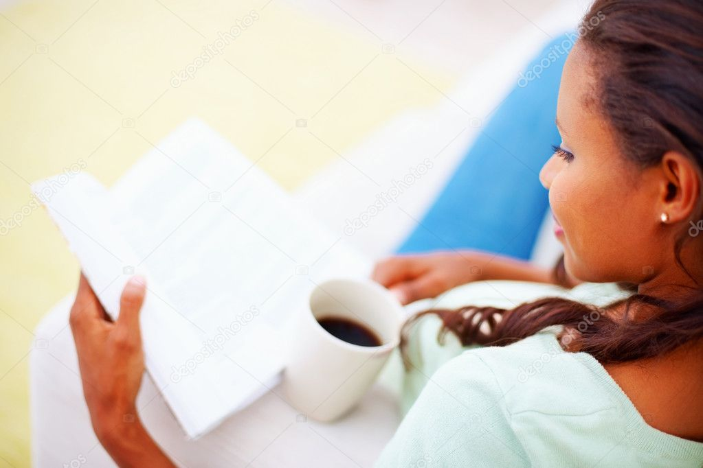 Cut image African American woman reading a book at tea time  Stock Photo #3336782