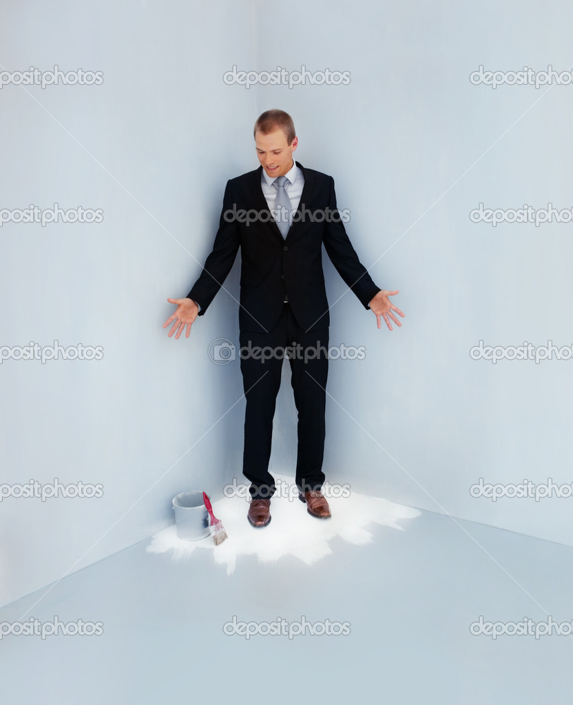 Full length of a handsome business man standing trapped at the corner of a fresh painted floor — Stock Photo #3337008