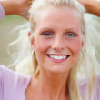 Closeup of a happy young female outdoors - Stock Photo