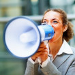 Royalty-Free Stock Photo: Business woman screaming into a megaphone