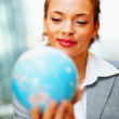 Royalty-Free Stock Photo: Happy young business woman with a globe